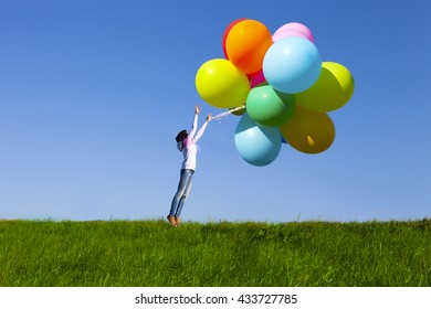 Happy Young Girl Holding a Bunch of Balloons