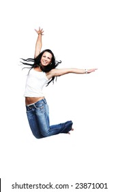 Happy young girl jumping, isolated on white, wearing white tank top, with copy space