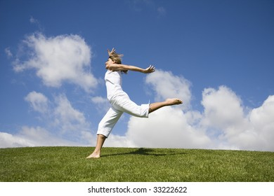 Happy young girl jumping on a beautiful landscape