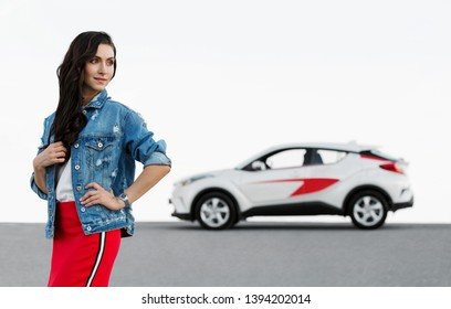 Happy young girl with new car. Woman city driver.