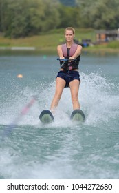 happy young girl on a water ski