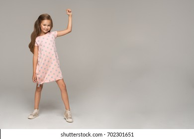 Happy young girl in pink dress