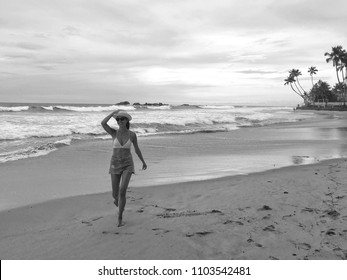 Happy young girl running at the beach, Sri Lanka