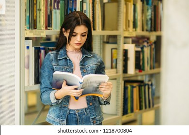Happy young girl student studing in library