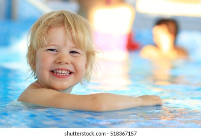 Happy young girl in swimming pool