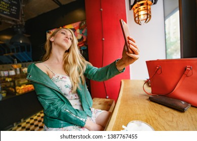Happy Young Girl Taking Selfie