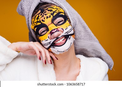 happy young girl with a towel on her head smiling, n alice mask with an animal face