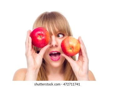 Happy young girl with two apples near her eyes , isolated on white