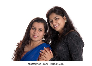 Happy young girls on a white background. Portrait.