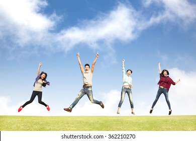 happy young group jumping together