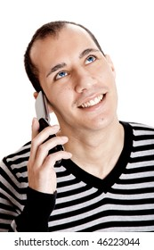 Happy young guy talking on cellphone isolated on white background
