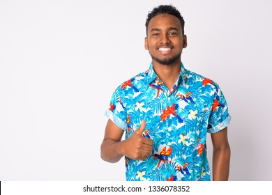 Happy young handsome African tourist man giving thumbs up