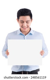 Happy young handsome asian man holding and showing blank paper or board ready for your text. Copy space.