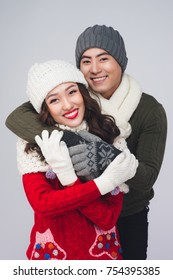 Happy young hipster couple hugging. Cold season. Romantic mood.
