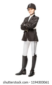 happy young horsewoman in uniform holding horseman stick and looking at camera isolated on white