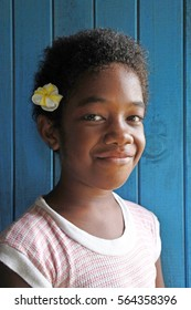 A happy young Indigenous Fijian Girl (age 8) looks at the camera and smile. Real people copy space