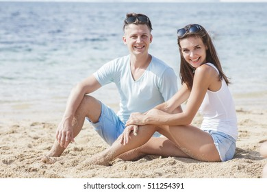 happy young Lovers enjoying sunny day at the beach
