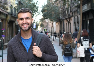 Happy young male heading to the university