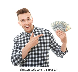 Happy young man with banknotes on white background