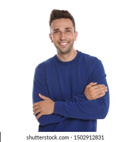 Happy young man in blue sweatshirt on white background. Winter season