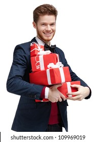 Happy young man carries a lot of presents, isolated on white