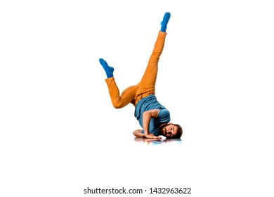 Happy young man dancing against plain white background