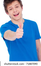 happy young man dressed casually giving thumbs up