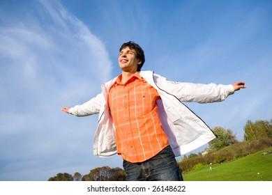 Happy young man - enjoy flies in sky