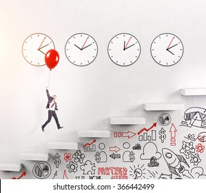 A happy young man flying up over stairs on a red balloon, four clocks on the white wall over seven steps, business signs painted on the wall under the stairs. Concept of career growth.