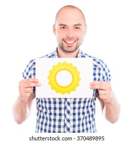 Happy young man with gear sign against the white