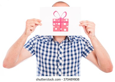 Happy young man with gift box sign