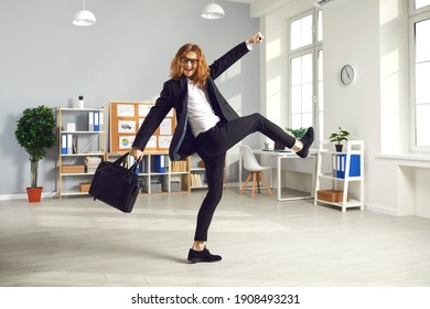 Happy young man having fun as it's time to finish work. Funny joyful white-collar worker holding briefcase and leaving office. Overjoyed long-haired male employee going home at the end of work day