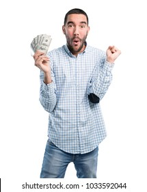 Happy young man holding a dollar bills