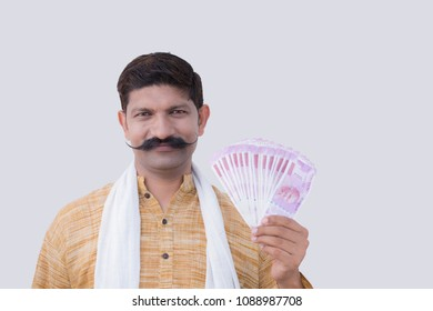 Happy young man holding Indian 2000 rupee notes