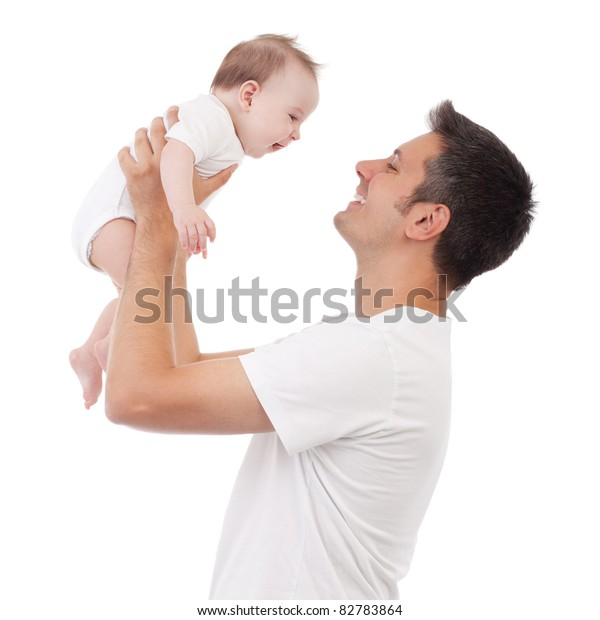 Happy young man holding a smiling 4-5 months old baby, isolated on white