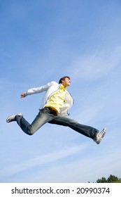 Happy young man - jumping  end flight in blue sky.