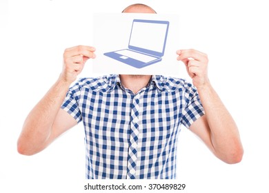 Happy young man with laptop computer sign