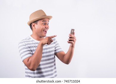 happy young man look at the smartphone and smile