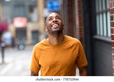 happy young man looking up