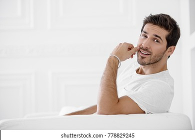 Happy young man looking at camera and smiling. Men's beauty and health.
