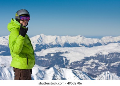 Happy young man on ski resort in high Alpine mountains