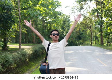 happy young man relax in green nature