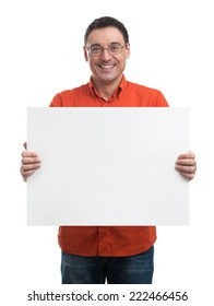 Happy young man showing and displaying placard ready for your text