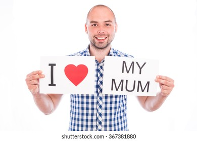 Happy young man with sign I love my mum