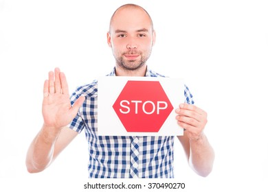 Happy young man with stop sign against the white