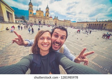 Happy young man taking a selfie photo in Bogota, Colombia. in the main square of the city called Bolivar square