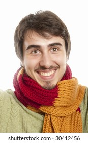 Happy young man wearing a scarf and green pullover