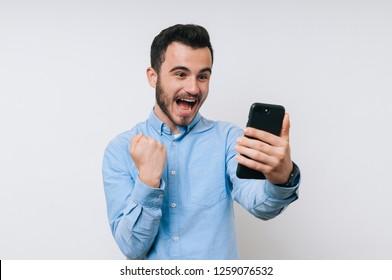 Happy young man is winner in online lottery
