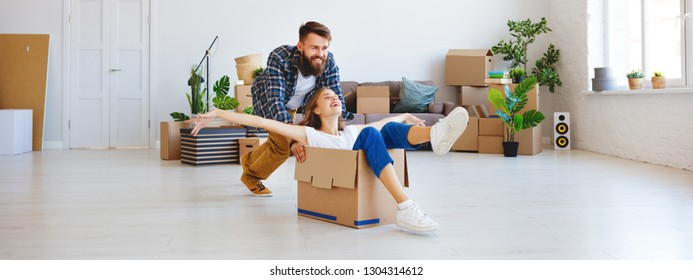 a happy young married couple moves to new apartment
