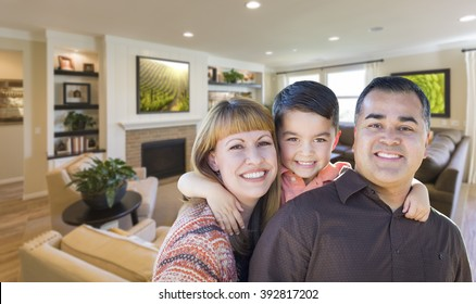 Happy Young Mixed Race Family Portrait In Living Room of Home.